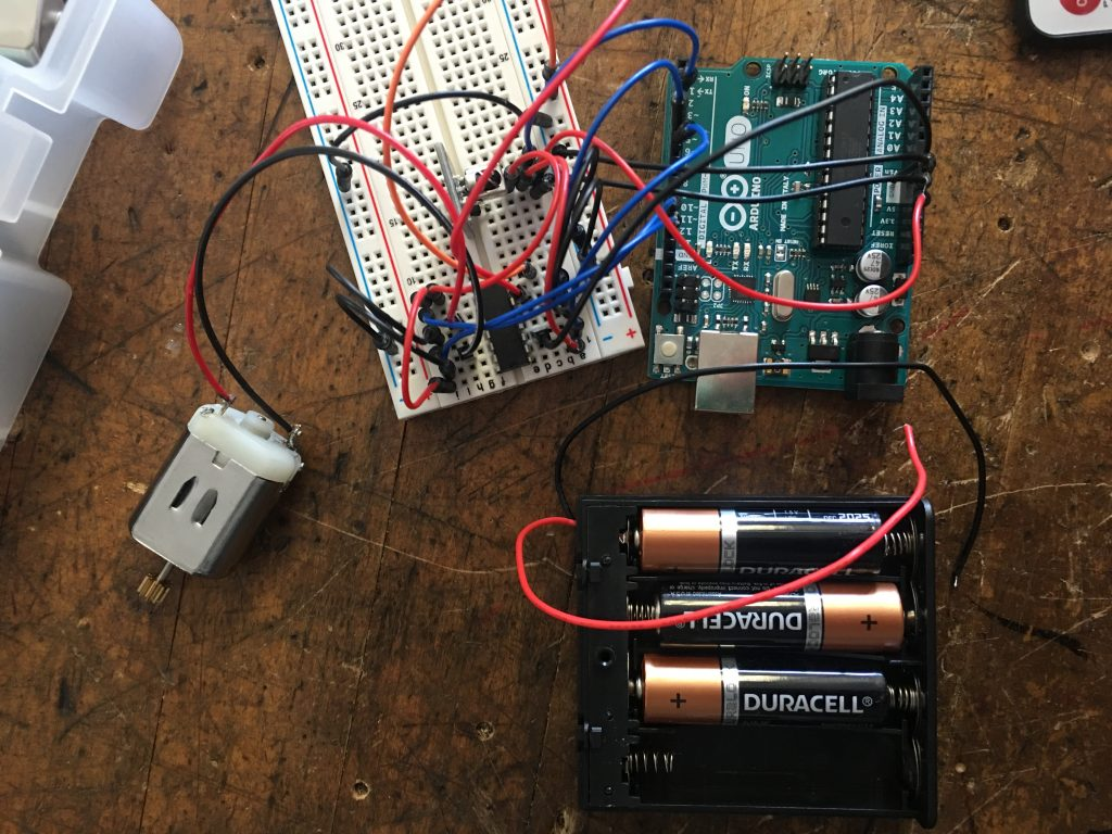 Arduino breadboard attached to several AA batteries.