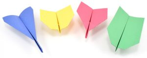 4 different types of paper airplanes, one blue, yellow, pink, and green.