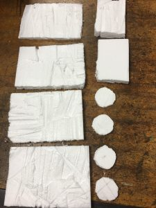 Pieces of styrofoam, 4 circles, 4 big rectangles, 2 small rectangles