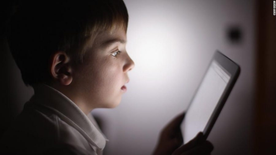 In this photograph illustration a ten-year-old boy uses an Apple Ipad