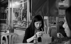 Phone addiction | KL Street OM D E-M1 by Johnragai-Moment Catcher is licensed under CC BY 2.0