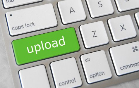 """""""Upload Key"""" by Got Credit is licensed with CC BY 2.0. To view a copy of this license, visit https://creativecommons.org/licenses/by/2.0/"""