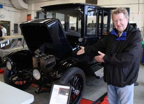 """Alf White admiring a very old electric car at the Future of Transportation Solar Energy Society event at NAIT"" by Green Energy Futures is licensed under CC BY-NC-SA 2.0"