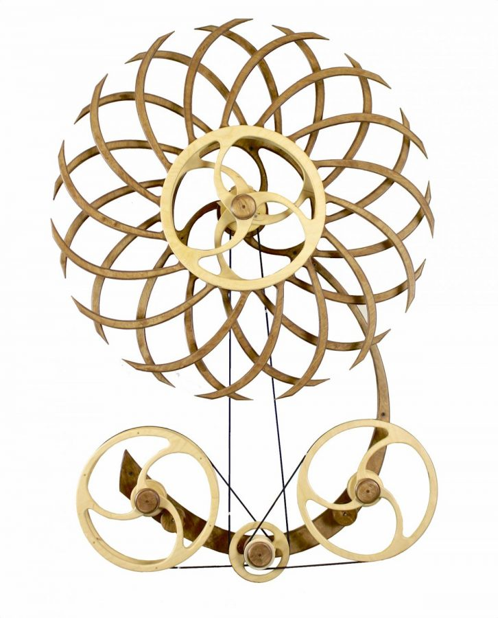 Metal Sculpture With Multiple Pieces And Gears Formed To Resemble A Flower