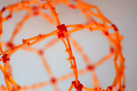 Orange Sphere Made Of Ribbing