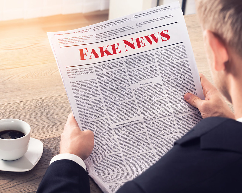 %22Fake+News+-+Person+Reading+Fake+News+Article%22+by+mikemacmarketing+is+licensed+under+CC+BY+2.0