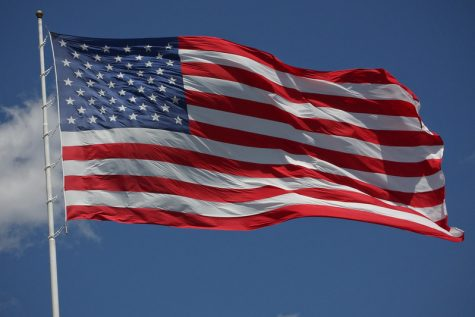 """The Flag of the United States"" by Sam Howzit is licensed under CC BY 2.0"