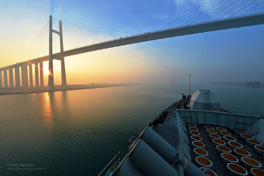 HMS Monmouth Passing Under the Suez Canal Bridge at Al Qantara, Egypt by Defence Images is licensed under CC BY-SA 2.0