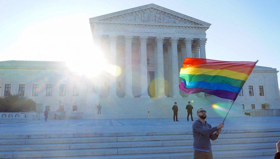 """SCOTUS APRIL 2015 LGBTQ 54663"" by tedeytan is licensed under CC BY-SA 2.0"